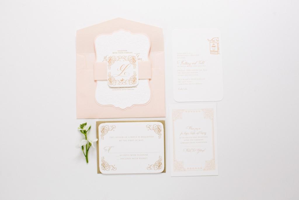 unique shape wedding invitation in blush and gold